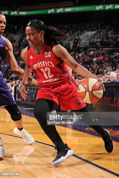 Ivory Latta of the Washington Mystics drives to the basket during the game against the Phoenix Mercury on July 5 2017 at Talking Stick Resort Arena...