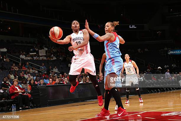 Ivory Latta of the Washington Mystics goes to the basket against the Atlanta Dream in a WNBA game at the Verizon Center on June 12 2015 in Washington...