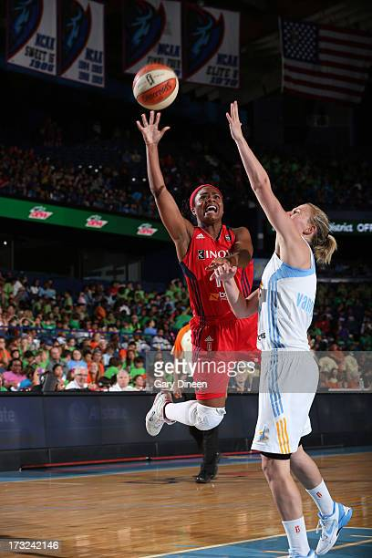 Ivory Latta of the Washington Mystics goes to the basket over Courtney Vandersloot of the Chicago Sky during the game on July 10 2013 at the Allstate...