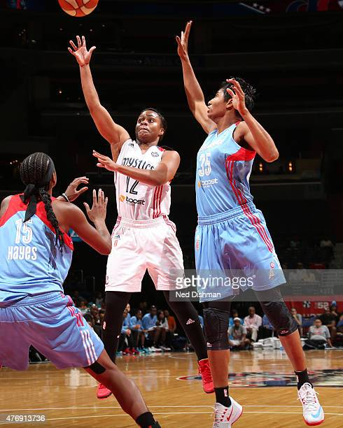 Ivory Latta of the Washington Mystics goes up for a shot against the Atlanta Dream in a WNBA game at the Verizon Center on June 12 2015 in Washington...