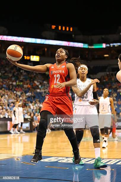 Ivory Latta of the Washington Mystics goes up for the shot against the Minnesota Lynx during the WNBA game on June 20 2014 at Target Center in...