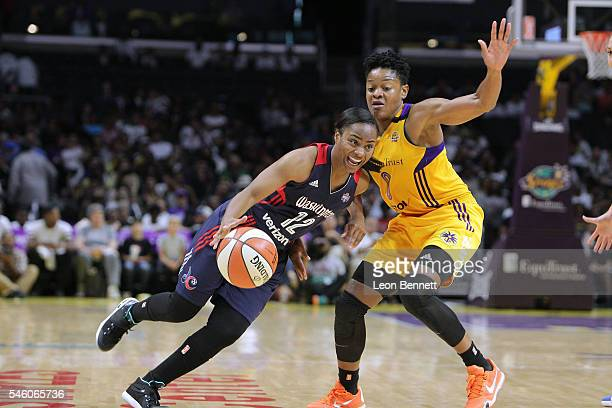 Ivory Latta of the Washington Mystics handles the ball against Alana Beard of the Los Angeles Sparks during WNBA basketball game at Staples Center on...