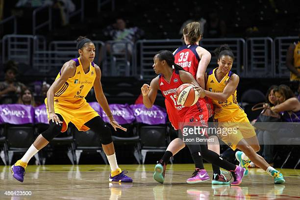 LOS Ivory Latta of the Washington Mystics handles the ball against Candace Parker and Kristi Toliver of the Los Angeles Sparks in a WNBA game at...