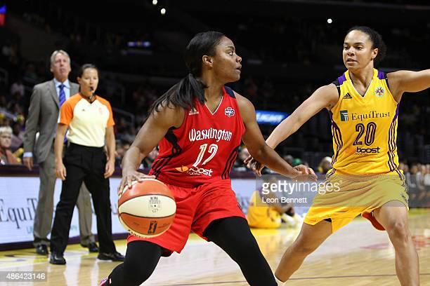 Ivory Latta of the Washington Mystics handles the ball against Kristi Toliver of the Los Angeles Sparks in a WNBA game at Staples Center on September...