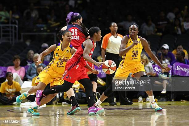 Ivory Latta of the Washington Mystics handles the ball against Kristi Toliver and Nneka Ogwumike of the Los Angeles Sparks in a WNBA game at Staples...