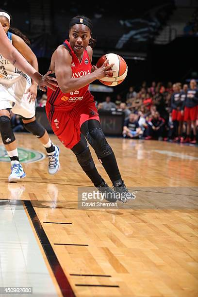 Ivory Latta of the Washington Mystics handles the ball against the Minnesota Lynx during the WNBA game on June 20 2014 at Target Center in...