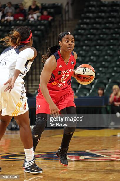 Ivory Latta of the Washington Mystics handles the ball against the Indiana Fever during the WNBA preseason game on May 6 2014 at Bankers Life...