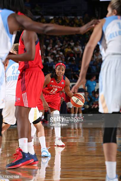Ivory Latta of the Washington Mystics looks to pass during the game against the Chicago Sky on July 10 2013 at the Allstate Arena in Rosemont...