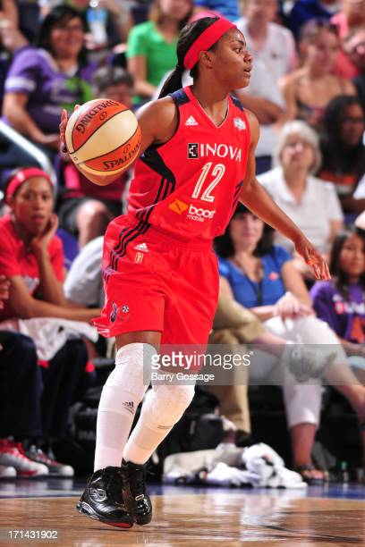 Ivory Latta of the Washington Mystics looks to pass the ball against the Phoenix Mercury on June 21 2013 at US Airways Center in Phoenix Arizona NOTE...