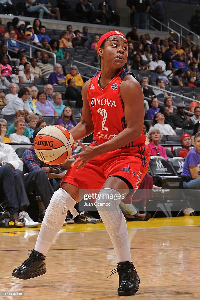 Ivory Latta #12 of the Washington Mystics looks to pass the ball against the Los Angeles Sparks at Staples Center on June 23, 2013 in Los Angeles, California.