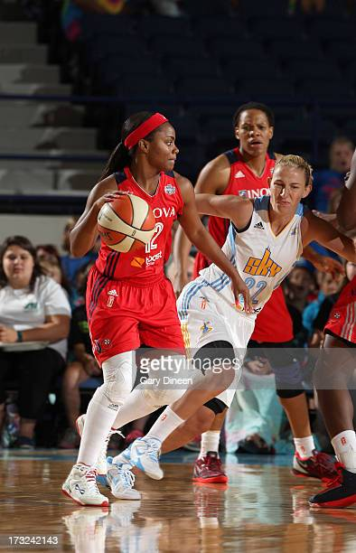 Ivory Latta of the Washington Mystics looks to pass while defended by Courtney Vandersloot of the Chicago Sky during the game on July 10 2013 at the...