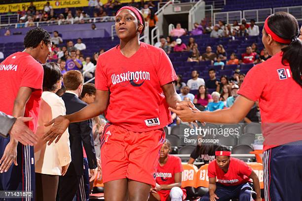 Ivory Latta of the Washington Mystics runs out before the game against the Phoenix Mercury on June 21 2013 at US Airways Center in Phoenix Arizona...