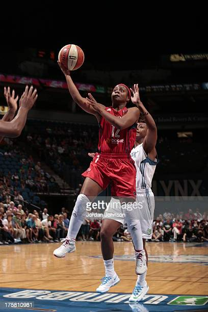 Ivory Latta of the Washington Mystics shoots against Monica Wright of the Minnesota Lynx during the WNBA game on August 8 2013 at Target Center in...