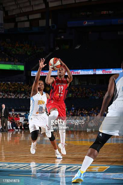 Ivory Latta of the Washington Mystics shoots in front of Epiphanny Prince of the Chicago Sky during the game on July 10 2013 at the Allstate Arena in...