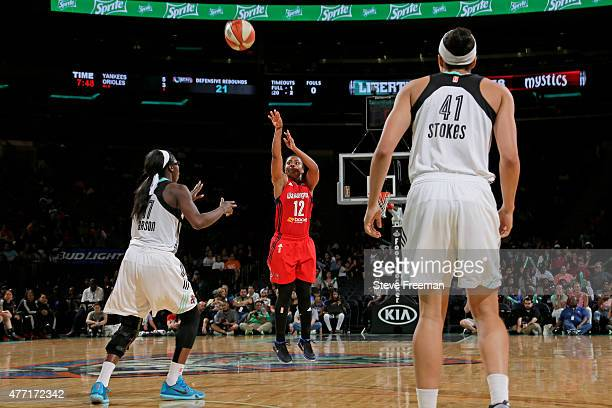 Ivory Latta of the Washington Mystics shoots the ball against the New York Liberty on June 14 2015 at Madison Square Garden in New York New York NOTE...
