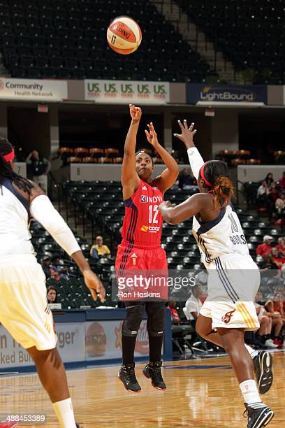 Ivory Latta of the Washington Mystics shoots the ball against the Indiana Fever during the WNBA preseason game on May 6 2014 at Bankers Life...
