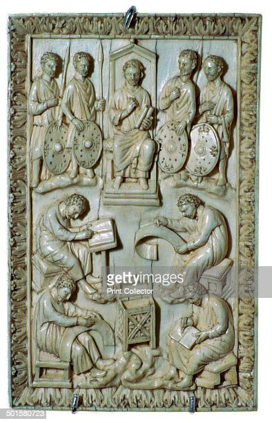 Ivory plaque of a reliquary from the treasure of St Denis showing King David dictating the psalms Now in the Louvre 10th century