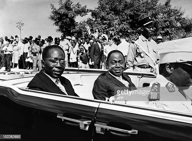 Ivory president Felix Houphouet Boigny and Senegalese President Leopold Sedar Senghor parade in the official car on August 10 1961 in Abidjan during...
