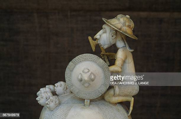 Ivory salt cellar with a lid depicting a Portuguese soldier holding a shield axe with his enemies' heads at his feet SapiPortuguese art 15th16th...