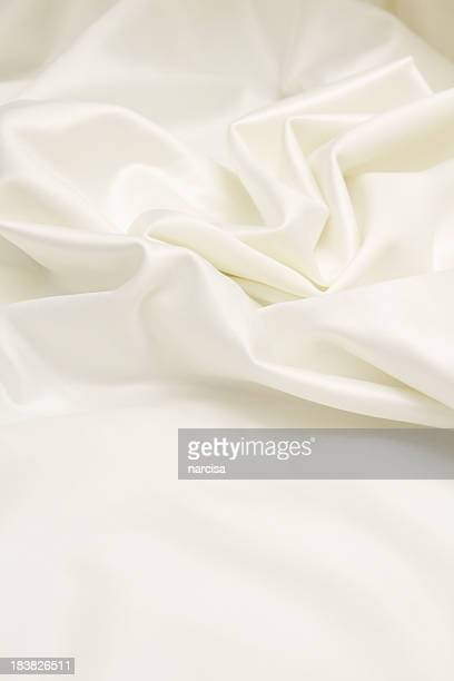 ivory satin silk vertical background - white satin stock photos and pictures