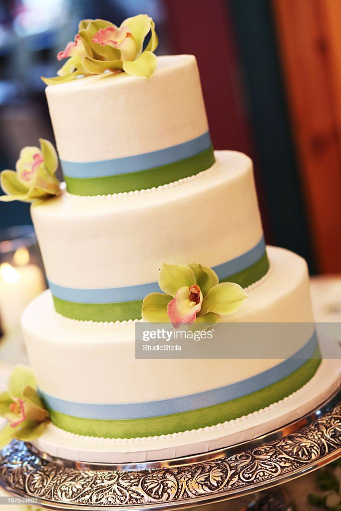 Ivory Wedding Cake With Lime Green Orchids Stock Photo | Getty Images