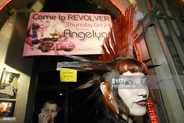 Ivy a girl wearing a punk coiffure waits in a queue to meet Gubernatorial candidate Angelyne the 'Hollywood Billboard Queen' at a bar in West...