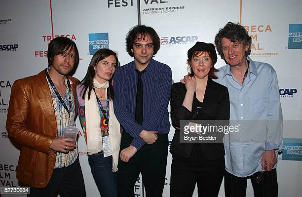Ivy Band members Andy Chase Dominique Durand Adam Schlesinger Singer Suzanne Vega and Singer Paul Buchanan poses for photographs at the Tribeca Film...