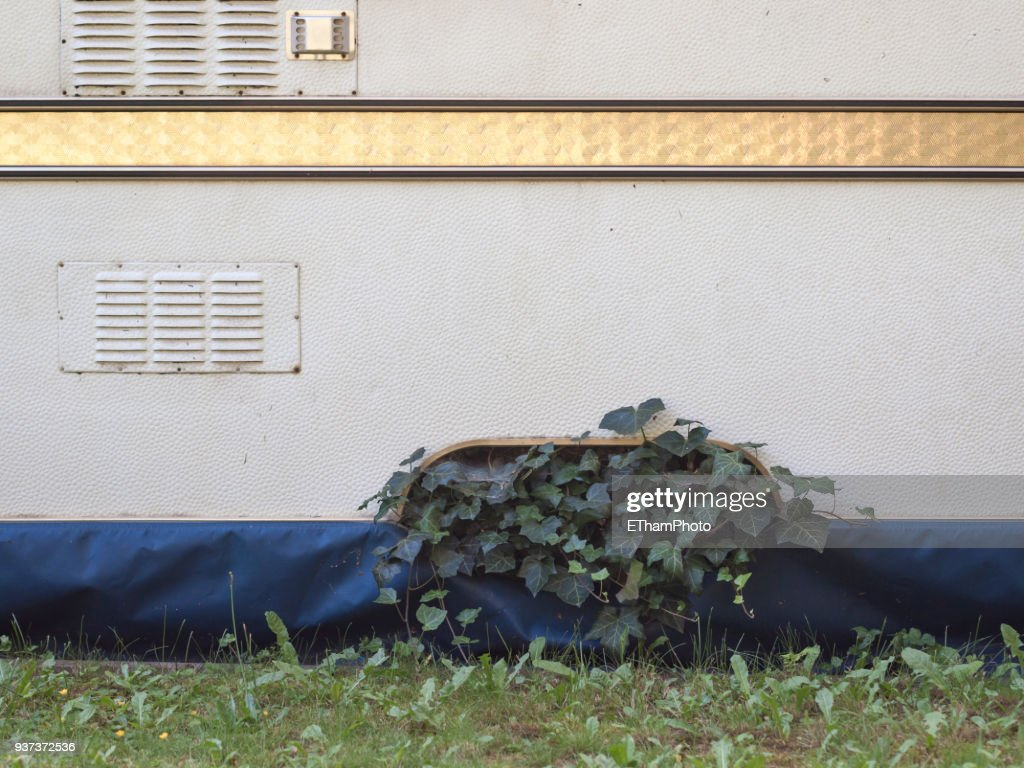 Ivy Growing On Stationary Mobile Home At Abandoned Camping Site