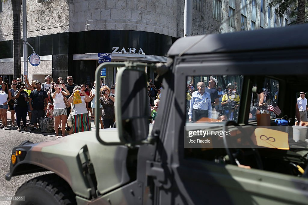 Ivy People Watch A Veterans Day Parade On November 11 2015 In Miami Beach