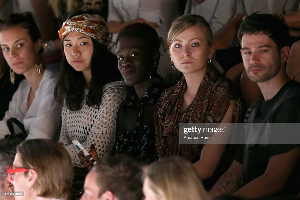 Ivy Quainoo (C) attends the Dimitri show during the Mercedes-Benz Fashion Week Spring/Summer 2014 at the Brandenburg Gate on July 3, 2013 in Berlin, Germany.