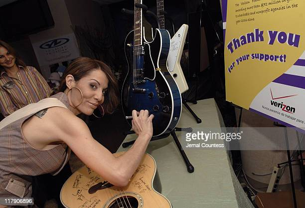 Ivy Queen at Verizon autographing a guitar during The 7th Annual Latin GRAMMY Awards Backstage Lounge by Distinctive Assets Day 2 at Madison Square...
