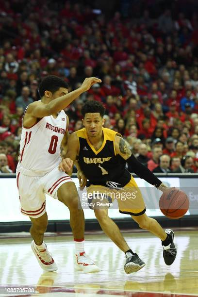 Ivy Smith Jr. #1 of the Grambling State Tigers is defended by D'Mitrik Trice of the Wisconsin Badgers during the second half at Kohl Center on...
