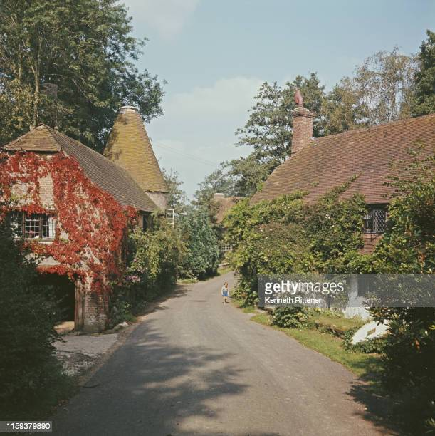 Ivycovered cottages and an oast house near the village of Framfield in East Sussex 1963