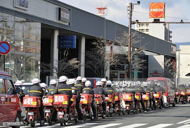 Iwaki Japan Postal delivery workers on motorbikes line up at a gas station in Iwaki Fukushima Prefecture on March 26 2011 Gasoline shortages have...