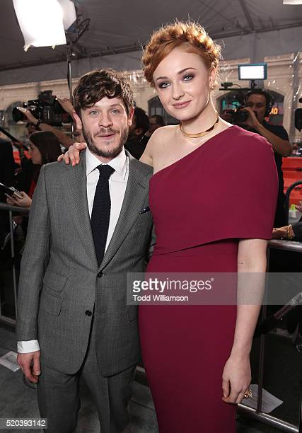 Iwan Rheon and Sophie Turner attend the premiere of HBO's 'Game Of Thrones' Season 6 at TCL Chinese Theatre on April 10 2016 in Hollywood California
