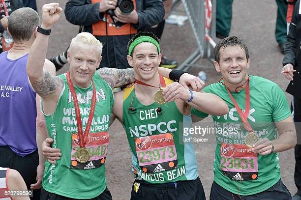Iwan Thomas Marcus Bean and Jack Ashton pose with their medals after completing the Virgin Money London Marathon on April 24 2016 in London England