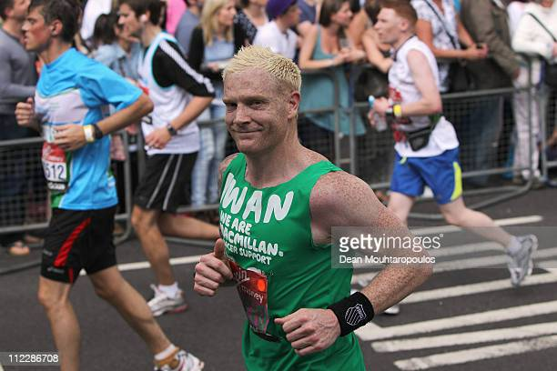 Iwan Thomas MBE runs down Lower Thames Street during the Virgin London Marathon 2011 on April 17 2011 in London England
