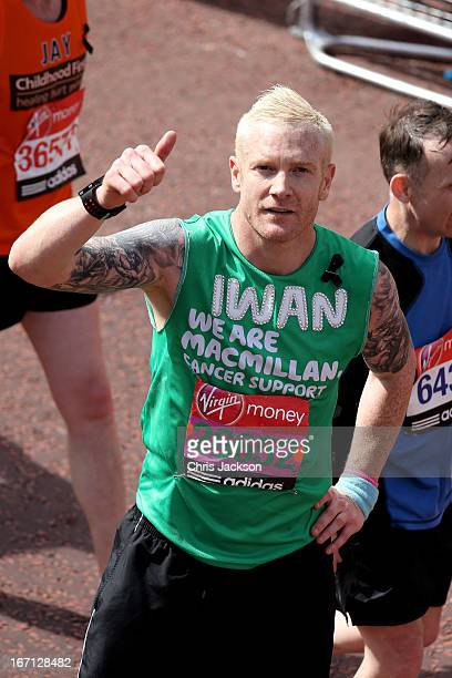 Iwan Thomas poses for the cameras after crossing the finish line during the Virgin London Marathon 2013 on April 21 2013 in London England
