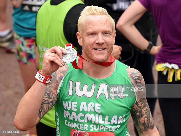 Iwan Thomas poses with his medal after completing the London Marathon on April 26 2015 in London England