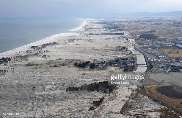 Iwanuma Japan A massive tsunami hits coastal areas of Iwanuma Miyagi Prefecture northeastern Japan on March 11 after a powerful earthquake
