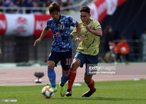Iwata Tomoki of Japan controls the ball against Colombia during the U-22 international friendly match between Japan and Colombia at Edion Stadium...