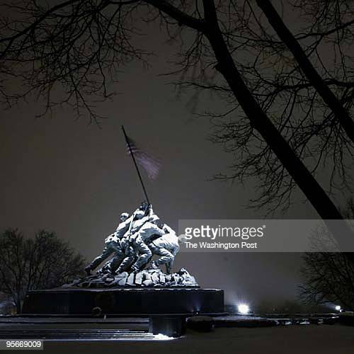 Iwo Jima Memorial on the night of a quiet snow storm in the DC Area The 60th anniversary of the flag raising commemoration of Iwo Jima was celebrated...