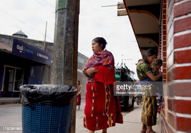 Ixil Mayan women wait for a transport van in Nebaj, Guatemala on January 4, 2019. Nebaj is set in the Cuchumatanes mountains and heavily effected by...