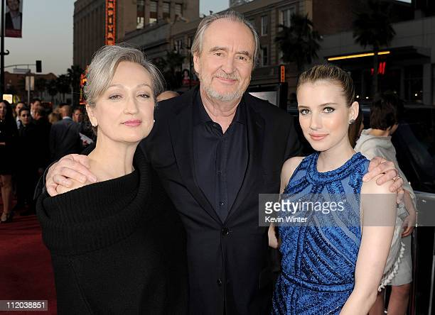 "Iya Labunka, director Wes Craven, and actress Emma Roberts arrive at the premiere of The Weinstein Company's ""Scream 4"" Presented by AXE Shower held..."