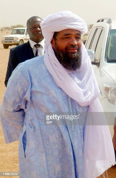 Iyad Ag Ghali leader of the Islamic group of Ansar Dine looks on at in Kidal airport before a meeting with Burkina Faso's foreign Minister Djibrille...