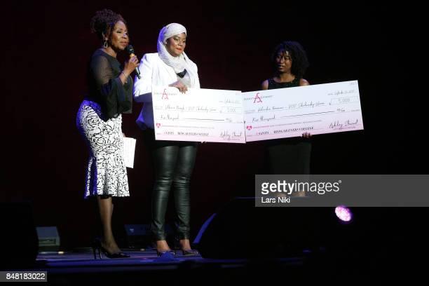 Iyanla Vanzant presents Latchmie Marajh and Kedeisha Freeman with the Medgar Evers Scholarship award onstage at Finding Ashley Stewart 2017 at Kings...