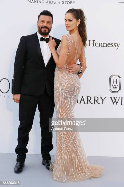 Izabel Goulart and a guest arrive at the amfAR Gala Cannes 2017 at Hotel du CapEdenRoc on May 25 2017 in Cap d'Antibes France