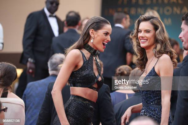Izabel Goulart and Alessandra Ambrosio attend the screening of 'Solo A Star Wars Story' during the 71st annual Cannes Film Festival at Palais des...