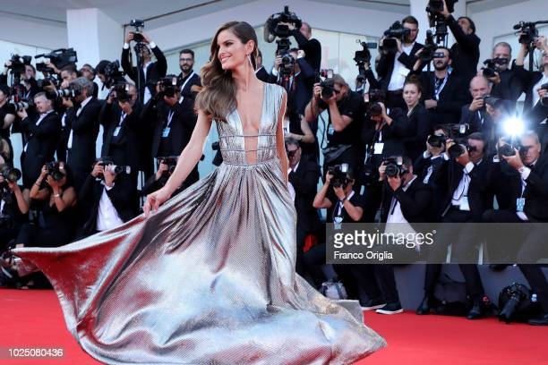 Izabel Goulart walks the red carpet ahead of the opening ceremony and the 'First Man' screening during the 75th Venice Film Festival at Sala Grande...