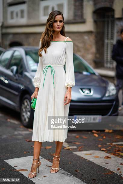 Izabel Goulart wears a white dress outside Valentino during Paris Fashion Week Womenswear Spring/Summer 2018 on October 1 2017 in Paris France